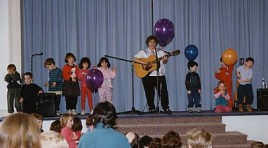 with children on stage